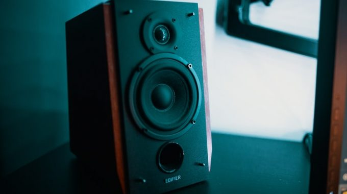 CAN A SUBWOOFER BE PLACED BEHIND A TV